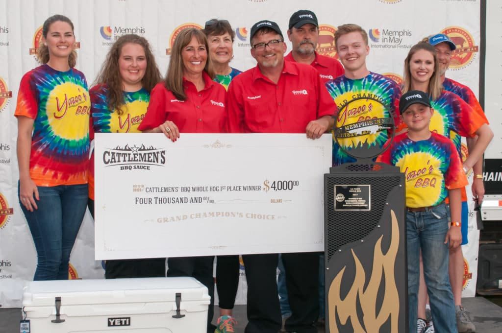 Left to Right - Marissa Roberts, Lauren Cookston, Melissa Cookston, Beverly Weaver (Melissa's Mother), Pete Cookston, Mark Nichols, Zack Cookston, Chad Nichols, Jessica Dennie, and Ben Dennie of Melissa Cookston's Yazoo's Delta Q barbecue team pose with the 1st place trophy in the whole hog category at the 2017 Memphis in May World Championship Barbecue Cooking Contest. PHOTO: Morris Marketing Group